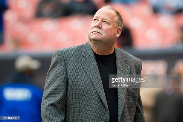 Team president Mike Holmgren of the Cleveland Browns stands on the field prior to the game against the Buffalo Bills at Cleveland Browns Stadium on...