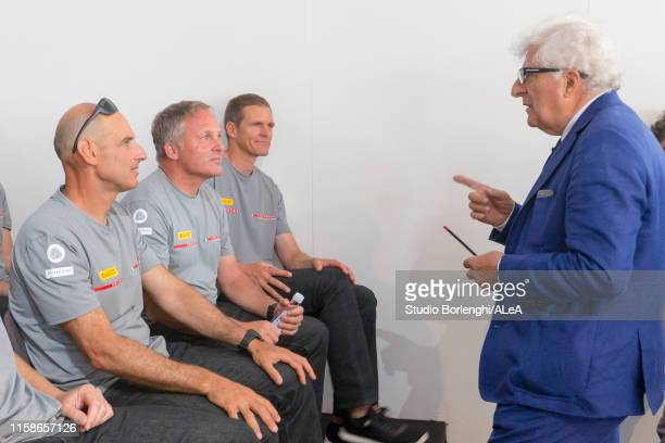 Team principal Patrizio Bertelli speaks with crew members during the Luna Rossa team presentation for the America's Cup 2021 on June 20, 2019 in...