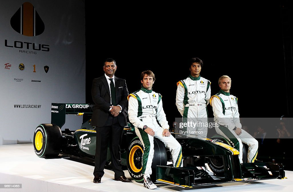 Team Principal Tony Fernandes, Jarno Trulli of Italy, Fairuz Fauzy of Malaysian , Heikki Kovalainen of Finland pose with the new Lotus T127 F1 car during the Lotus F1 launch at The Royal Horticultural Halls on February 12, 2010 in London, England.