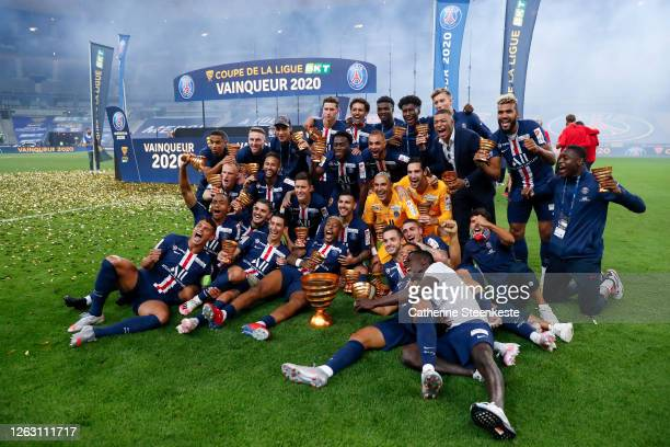 Team PSG celebrates the victory of the French League Cup final between Paris Saint Germain and Olympique Lyonnais at Stade de France on July 31, 2020...