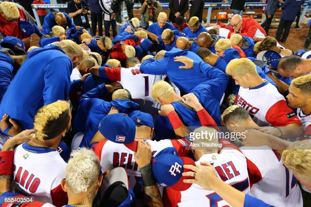 Team Puerto Rico huddles after losing Game 3 of the Championship Round of the 2017 World Baseball Classic against Team USA on Wednesday March 22 2017...