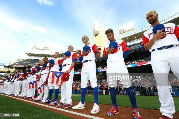 Team Puerto Rico stands for the national anthems prior to Game 1 of Pool F of the 2017 World Baseball Classic against Team Dominican Republic on...