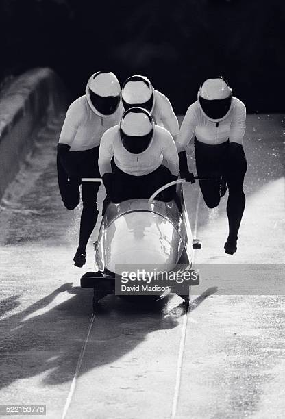 Team Pushing Bobsled