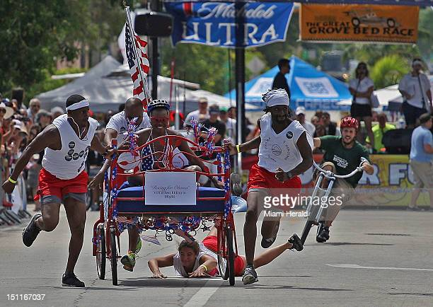 Team Racing for Obama loses a member as they participate in the first heat of the Coconut Grove Bed Race Fivemember teams in costume raced homemade...