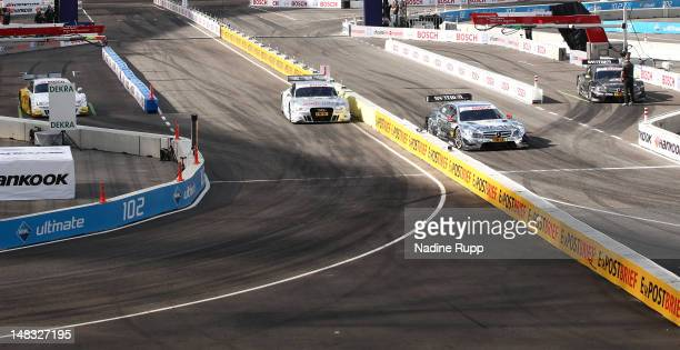 Team Ralf Schumacher and Jamie Green on the right side win the final race against team Adrien Tambay and Timo Scheider on the left side during the...