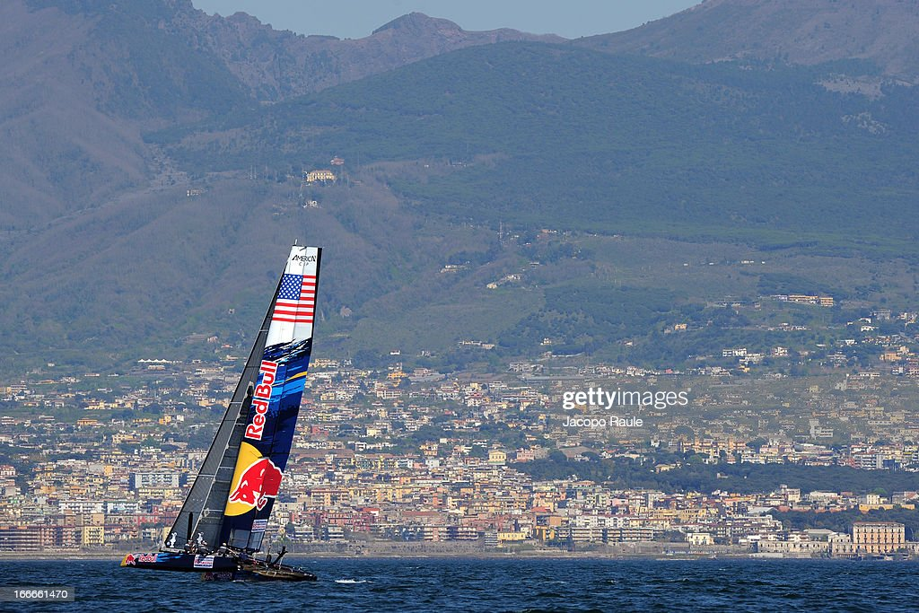 Team Red Bull take part in training ahead of the AC World Series in front of Mount Vesuvius on April 15, 2013 in Naples, Italy. Team Red Bull are entering the America's Cup World Series at the Naples stage under the banner of HS Team, sailed by Austrians Roman Hagara and Hans-Peter Steinacher. HS Team will be sailing in partnership with ORACLE