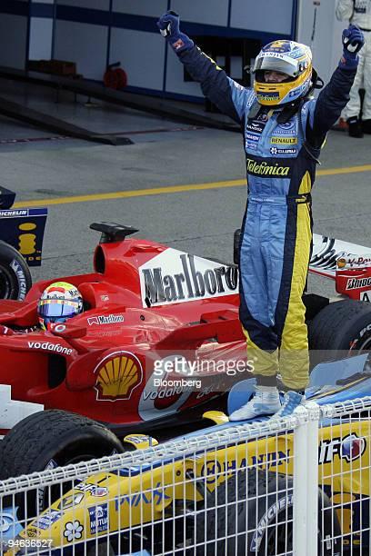 Team Renault driver Fernando Alonso celebrates winning the Formula 1Grand Prix of Japan in Suzuka on Sunday October 8 2006