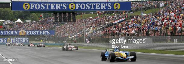 Team Renault driver Fernando Alonso from Spain races during the Formula 1 Grand Prix in Budapest Hungary Sunday August 6 2006