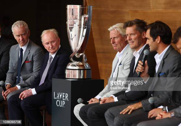Team Rest of the World captain John McEnroe and Rod Laver listen as Roger Federer of Team Europe answers questions at the official welcome ceremony...