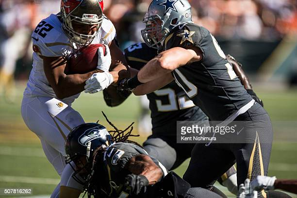 Team Rice running back Doug Martin of the Tampa Bay Buccaneers is stopped by Team Irvin cornerback Richard Sherman of the Seattle Seahawks and Sean...
