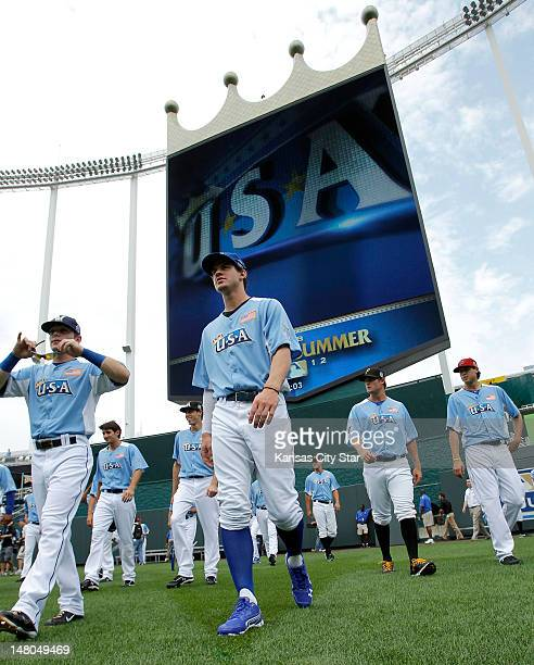 Team right fielder Wil Myers walks back to the dugout with the rest of the team after posing for a team picture during the All-Star Futures baseball...