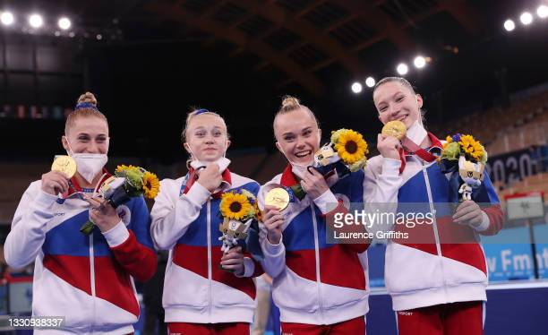 Team ROC celebrate with their Gold Medals after victory in the Women's Team Final on day four on day four of the Tokyo 2020 Olympic Games at Ariake...