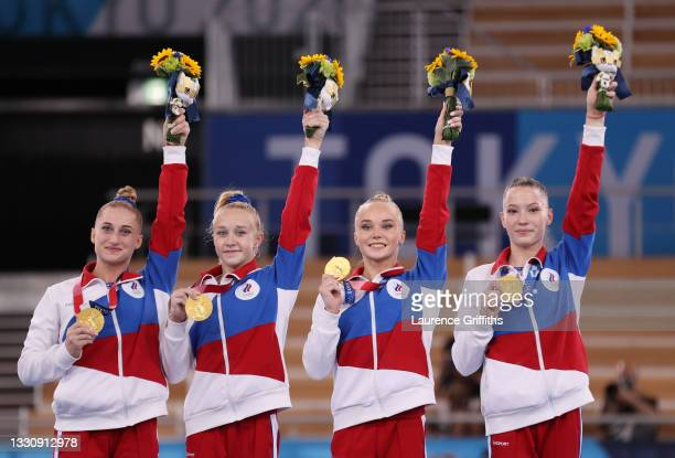 Team ROC celebrates on the podium after winning the gold medal during the Women's Team Final on day four of the Tokyo 2020 Olympic Games at Ariake...