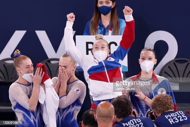 Team ROC celebrates winning the gold medal during the Women's Team Final on day four of the Tokyo 2020 Olympic Games at Ariake Gymnastics Centre on...