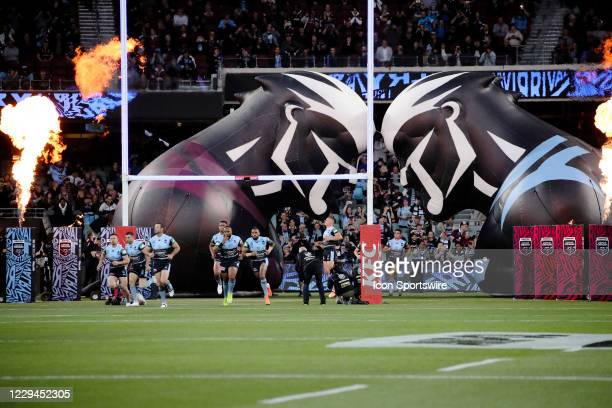 Team run out at start of game one of the 2020 State of Origin series between the Queensland Maroons and New South Wales Blues at the Adelaide Oval on...