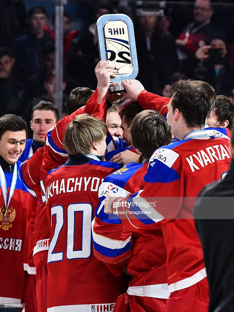 Team Russia celebrate their victory with the IIHF bronze trophy during the 2017 IIHF World Junior Championship bronze medal game against Team Sweden at the Bell Centre on January 5, 2017 in Montreal, Quebec, Canada. Team Russia defeated Team Sweden 2-1 in overtime to win the bronze medal.