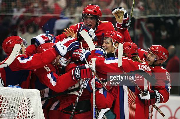 Team Russia celebrates defeating Canada 20 in their quarter final of the men's ice hockey match during Day 12 of the Turin 2006 Winter Olympic Games...