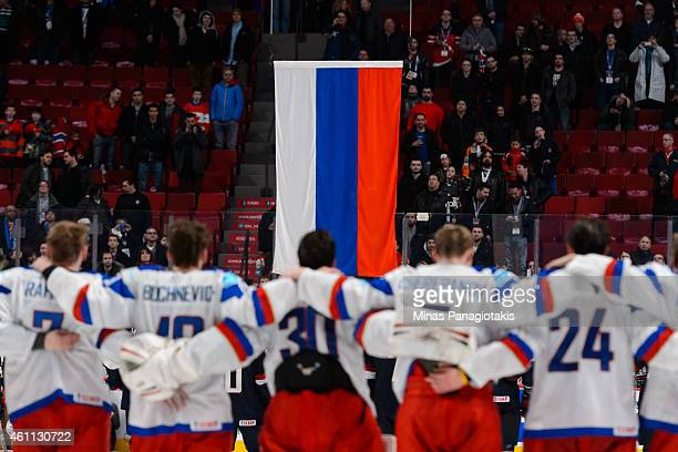 Team Russia line up to watch the Russian flag raised after their victory over Team United States in a quarterfinal round during the 2015 IIHF World...