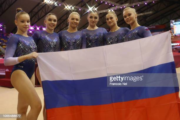 Team Russia pose for a photograph after they win the silver medal for the Women's team final during day six of the 2018 FIG Artistic Gymnastics...