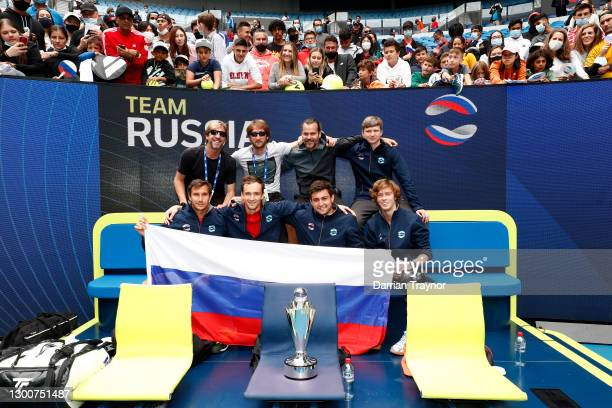 Team Russia pose with the ATP Cup Trophy after defeating Italy in the Final during day six of the 2021 ATP Cup at Rod Laver Arena on February 07,...