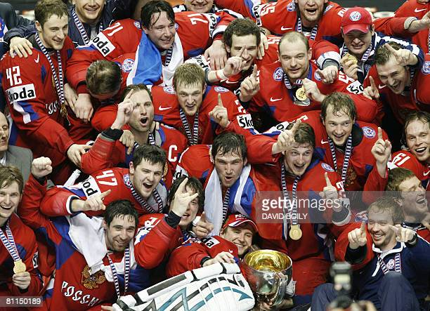Team Russia pose with the trophy after winning in overtime over Canada 5-4 during the gold medal game at the 2008 IIHF World Championships on May 18,...