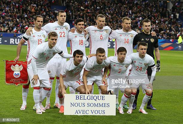 Team Russia poses with a sign showing their support after of the terrorist attacks in Brussel before the international friendly match between France...