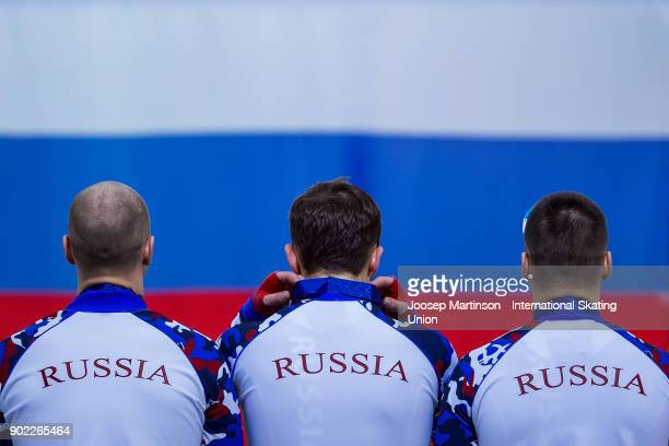 Team Russia react in the Men's Team Sprint medal ceremony during day three of the European Speed Skating Championships at the Moscow Region Speed...