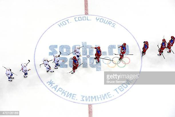 Team Russia shakes hands with Norway after defeating them 4 to 0 in the Men's Ice Hockey Qualification Playoff game on day eleven of the Sochi 2014...