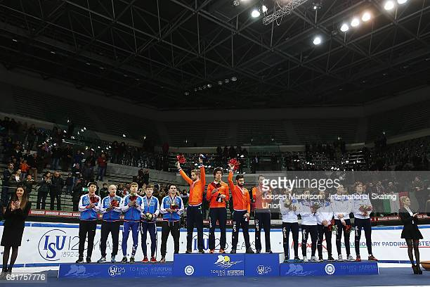 Team Russia team Netherlands and team Italy react in the Men's 5000m relay medal ceremony during day 2 of the European Short Track Speed Skating...