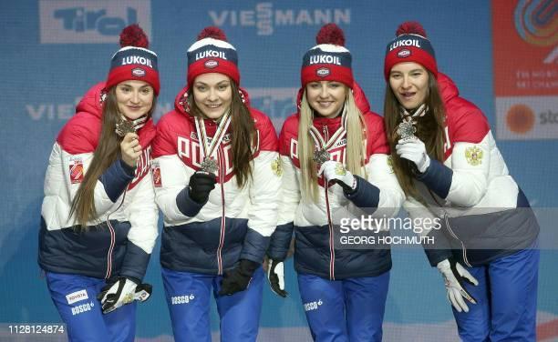 Team Russia with Yulia Belorukova Anastasia Sedova Anna Nechaevskaya and Natalia Nepryaeva celebrate their bronze medal during the medal ceremony for...