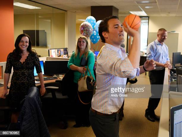 Team Select Home Care community relations representative Mark Prussin tries to make a long distance shot to the hoop at the Team Select offices March...