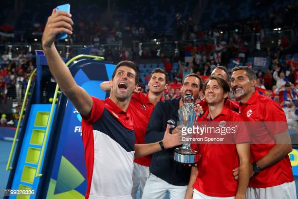 Team Serbia celebrate after defeating Spain to win the ATP Cup on day 10 of the ATP Cup at Ken Rosewall Arena on January 12, 2020 in Sydney,...