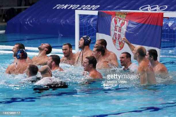 Team Serbia celebrate the win during the Men's Gold Medal match between Greece and Serbia on day sixteen of the Tokyo 2020 Olympic Games at Tatsumi...