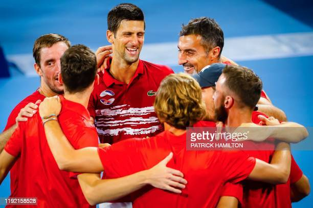 Team Serbia celebrate their victory in the men's doubles match on day four of the ATP Cup tennis between France and Serbia in Brisbane on January 06,...