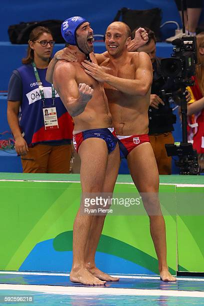 Team Serbia celebrate winning the Men's Water Polo Gold Medal match between Croatia and Serbia on Day 15 of the Rio 2016 Olympic Games at the Olympic...