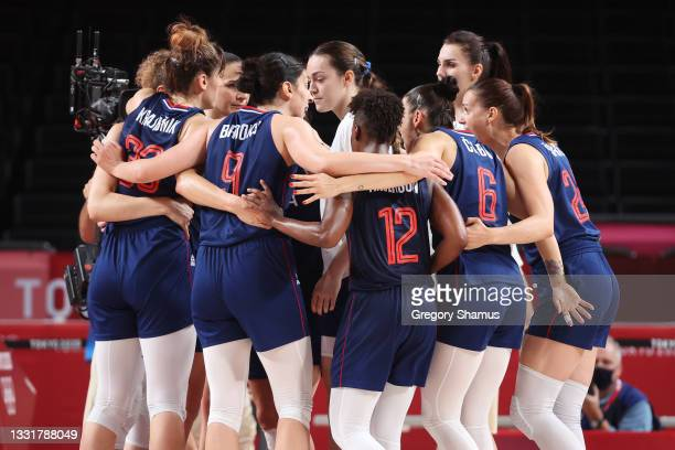 Team Serbia celebrates their victory over Team South Korea during the second half of a Women's Basketball Preliminary Round Group A game at Saitama...