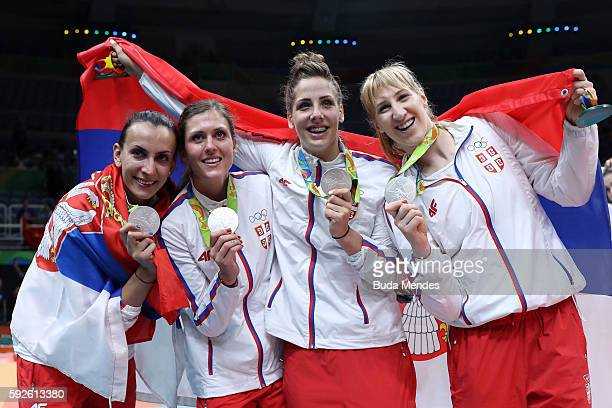 Team Serbia celebrates winning silver during the Women's Gold Medal Match between Serbia and China on Day 15 of the Rio 2016 Olympic Games at the...