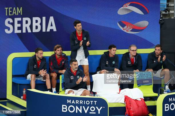 Team Serbia encourage Dusan Lajovic during his singles match against Roberto Bautista Agut of Spain on day 10 of the ATP Cup at Ken Rosewall Arena on...