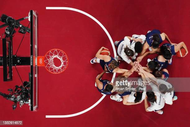 Team Serbia huddles together before the start of a Women's Basketball Semifinals game between Team United States and Team Serbia on day fourteen of...