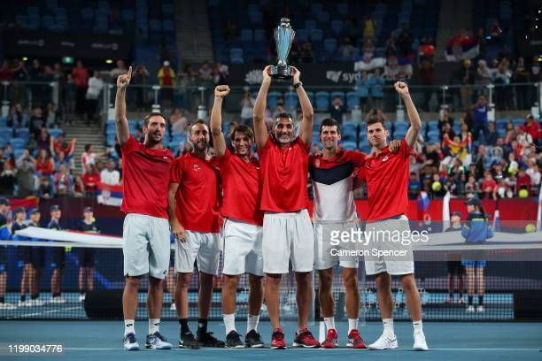 Team Serbia lift the ATP Cup trophy after defeating Spain on day 10 of the ATP Cup at Ken Rosewall Arena on January 12 2020 in Sydney Australia