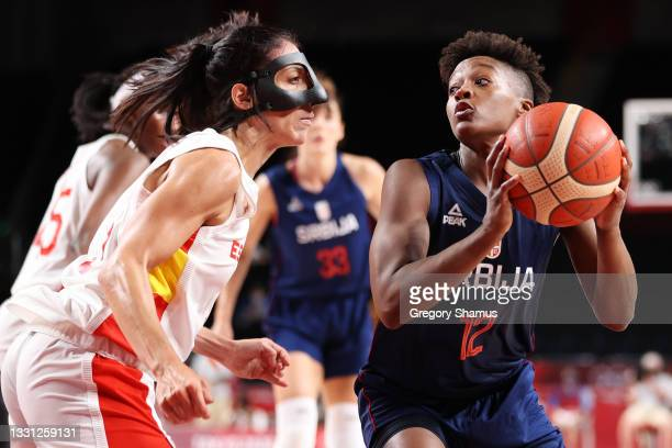 Team Serbia point guard Yvonne Anderson drives to the basket against Team Spain point guard Cristina Ouvina during the second half of a Women's...