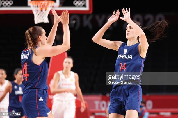 Team Serbia power forward Maja Skoric and centre Dragana Stankovic high five during the first half of their Women's Preliminary Round Group A game...