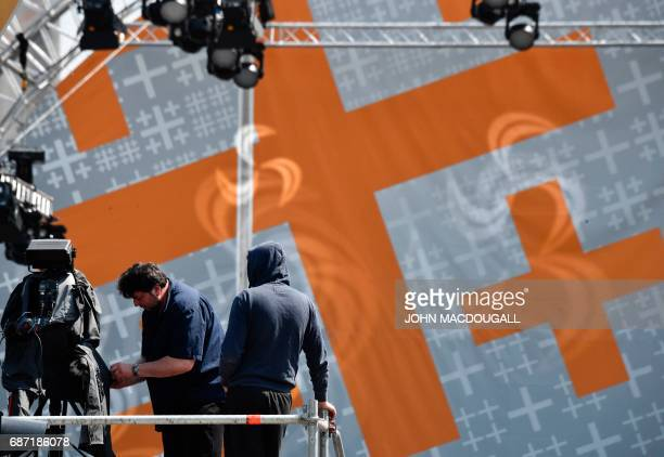 A team sets up a live camera in front of a temporary stage in front of the Brandenburg Gate sealed off ahead of the Kirchentag festival celebrating...