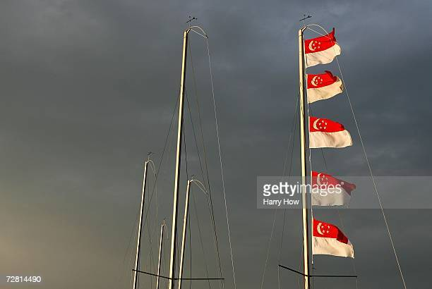 Team Singapore's flags are raised after they won the gold medal in the Beneteau 75 Open Final Race at the 15th Asian Games Doha 2006 at the Doha...