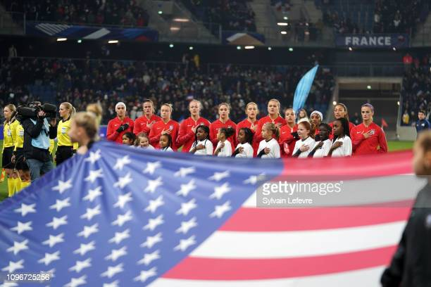 USA team sings national hymn in front of US flag before friendly soccer match between France and USA at Oceane Stadium on January 19 2019 in Le Havre...