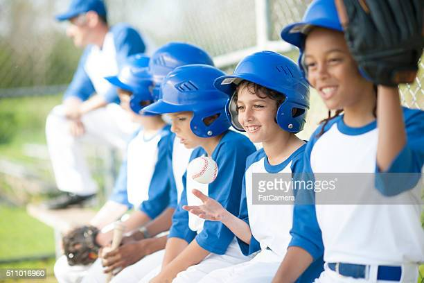 team sitting on the bench - baseball sport stock pictures, royalty-free photos & images
