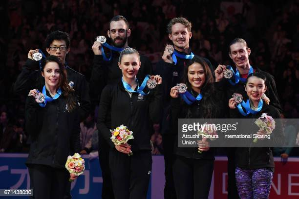 USA team skaters pose on the podium with their bronze medals during the 3rd day of the ISU World Team Trophy 2017on April 22 2017 in Tokyo Japan
