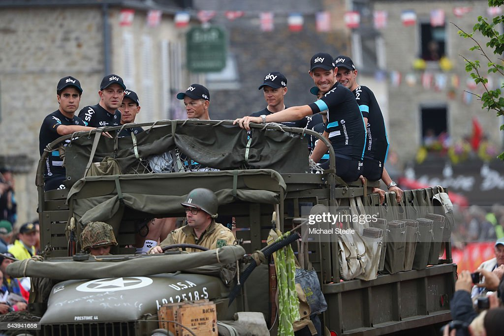 Team Sky arrive in a first war military vehicle during the team presentations on June 30, 2016 in Sainte-Mere-Eglise, France.