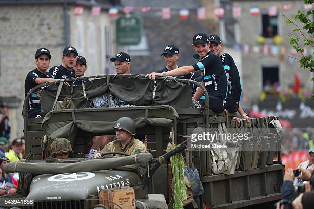 Team Sky arrive in a first war military vehicle during the team presentations on June 30 2016 in SainteMereEglise France