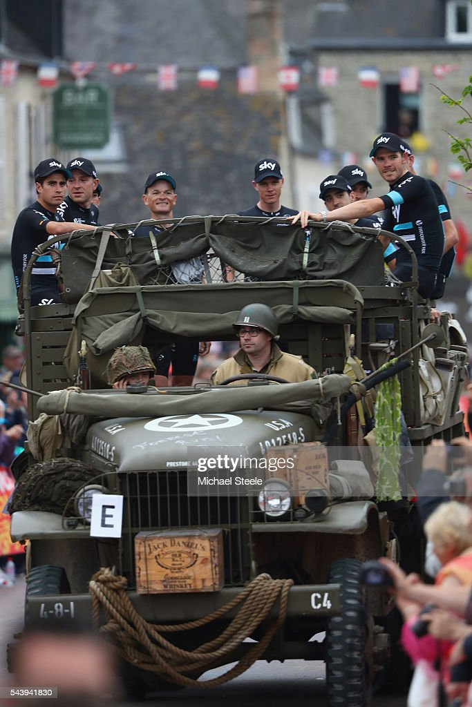 Team Sky arrive in a first world war military vehicle during the team presentations on June 30, 2016 in Sainte-Mere-Eglise, France.